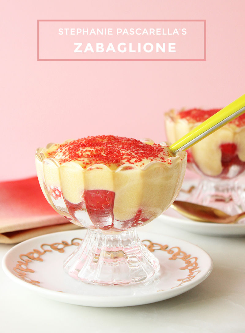Strawberry zabaglione with red sprinkles on gold and white dishes.