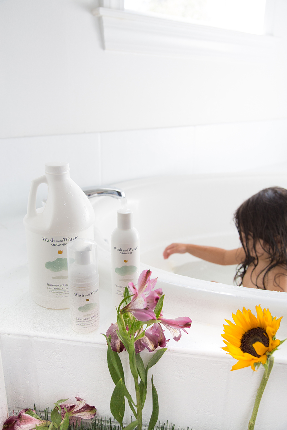 Stephanie Pascarella's daughter plays in the bath with Wash With Water products.