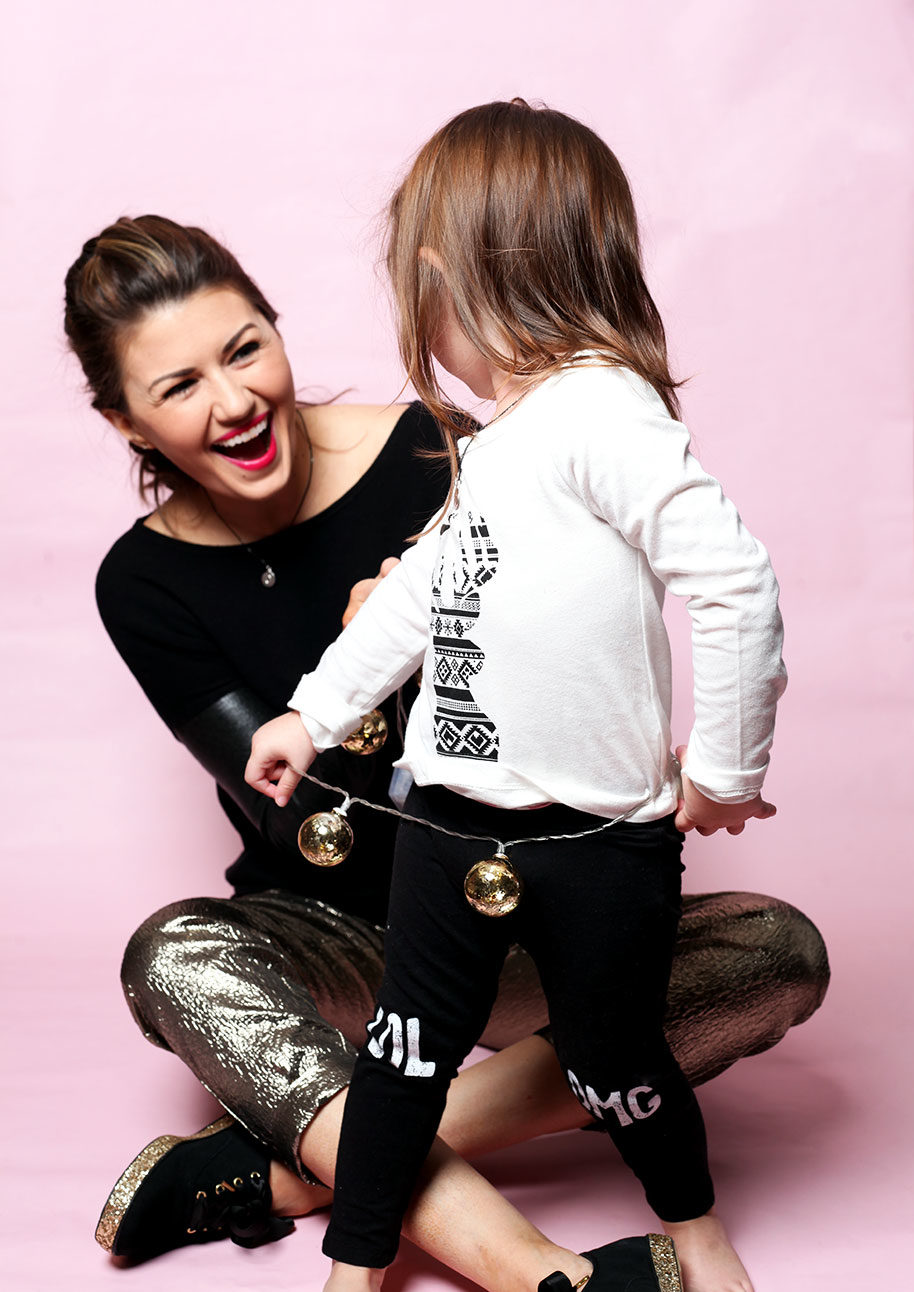A little girl wearing FabKids in a holiday gift guide.