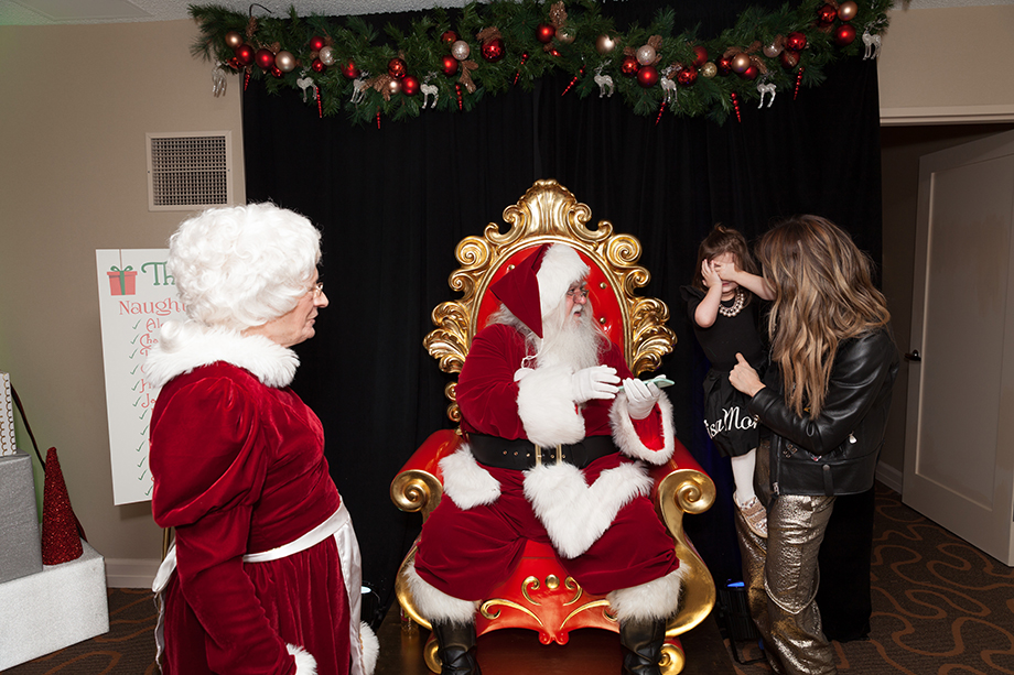A little girl hiding her eyes from Santa at the Swissotel in Chicago.