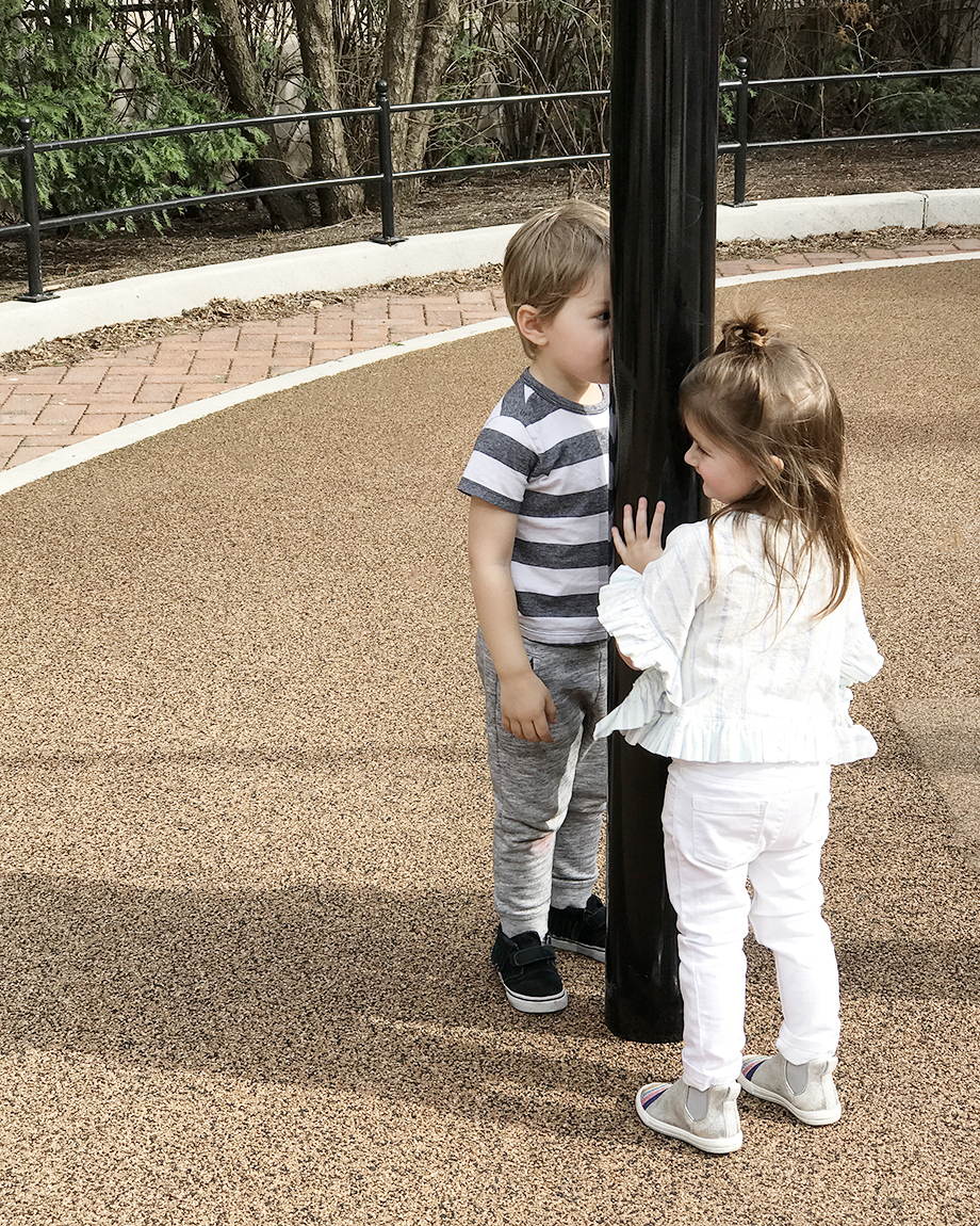 Two toddlers playing in the park near the Swissotel in Chicago.