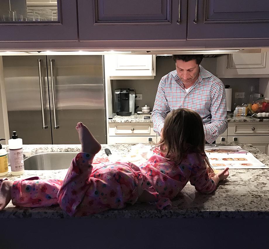 Zelda and Spiro in the kitchen making dinner.