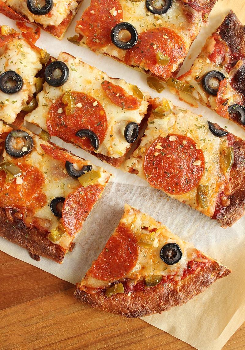 Fathead pizza made with almond flour, mozzarella and cream cheese.