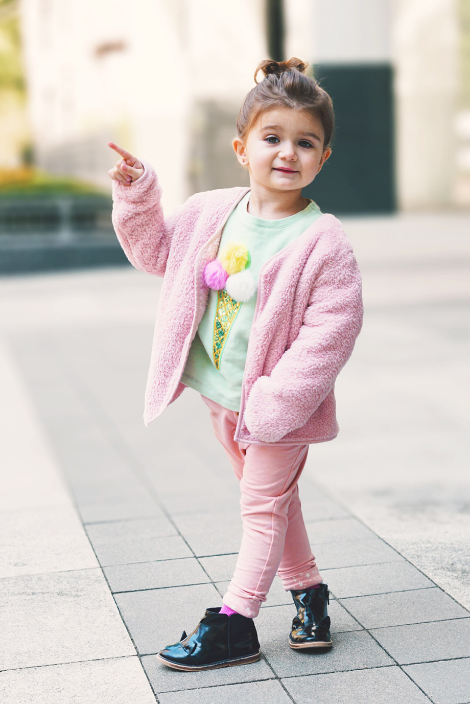 Little girls ice cream sweater, pink pants, and a pink jacket.