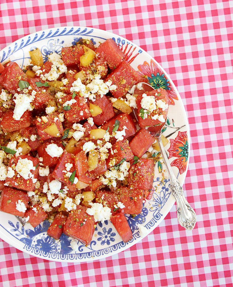 Watermelon salad with pistachios and cheese.