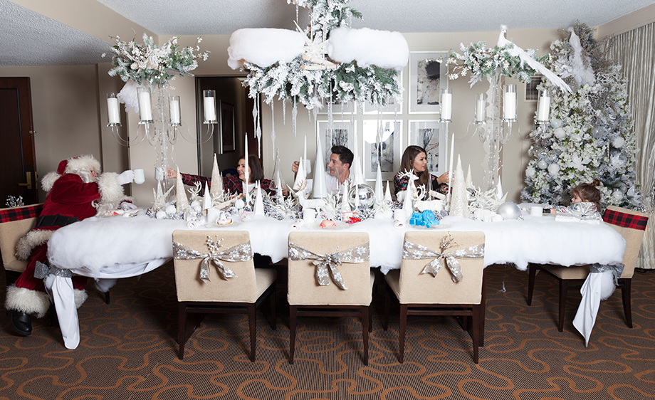 A family eats dinner in the Santa Suite of the Swissotel.