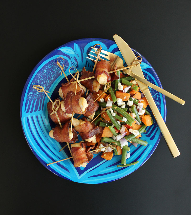 A kid and adult friendly dinner recipe for bacon wrapped chicken bites and veggie feta salad.