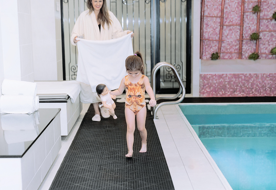 A mother daughter duo from Glitter and Bubbles swims at the indoor pool at the Waldorf Chicago.