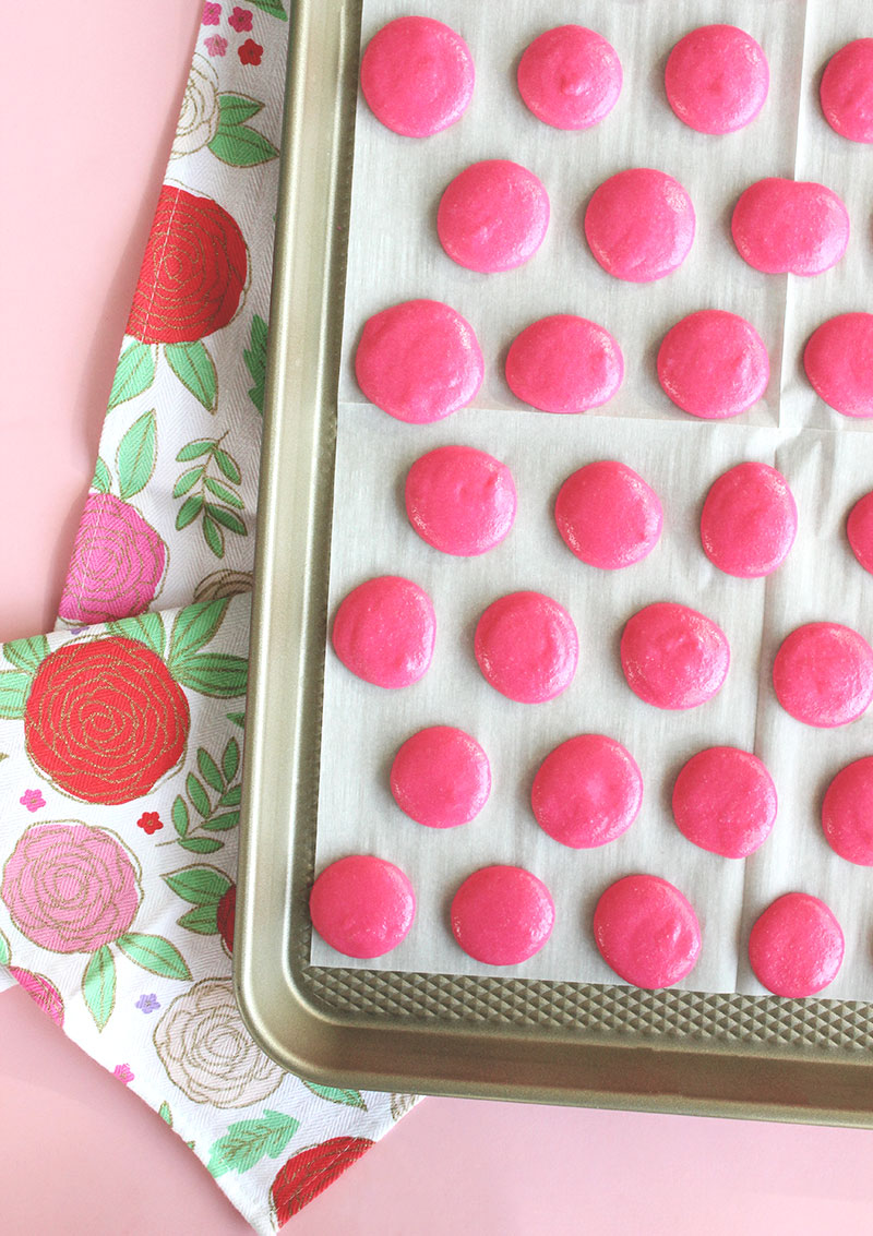 Use a piping bag to make French macarons.