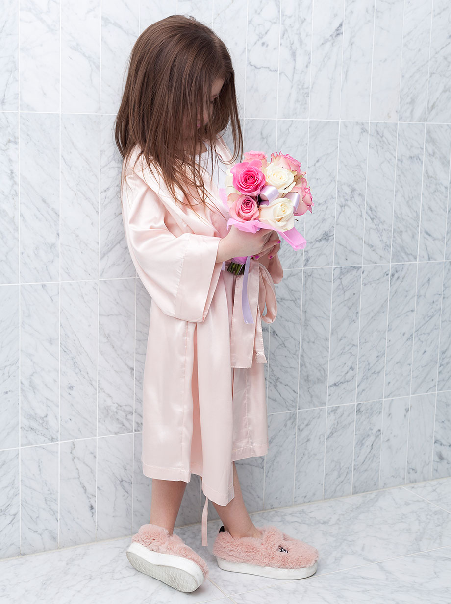 A pink flower girl robe with rhinestones.