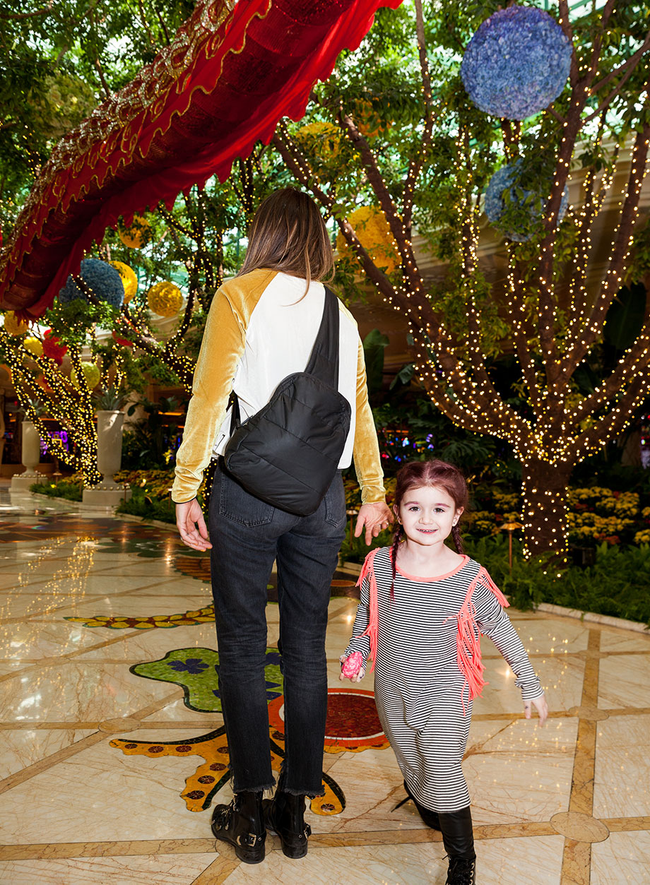 Corri McFadden and her daughter Zelda walk through The Wynn in Las Vegas.