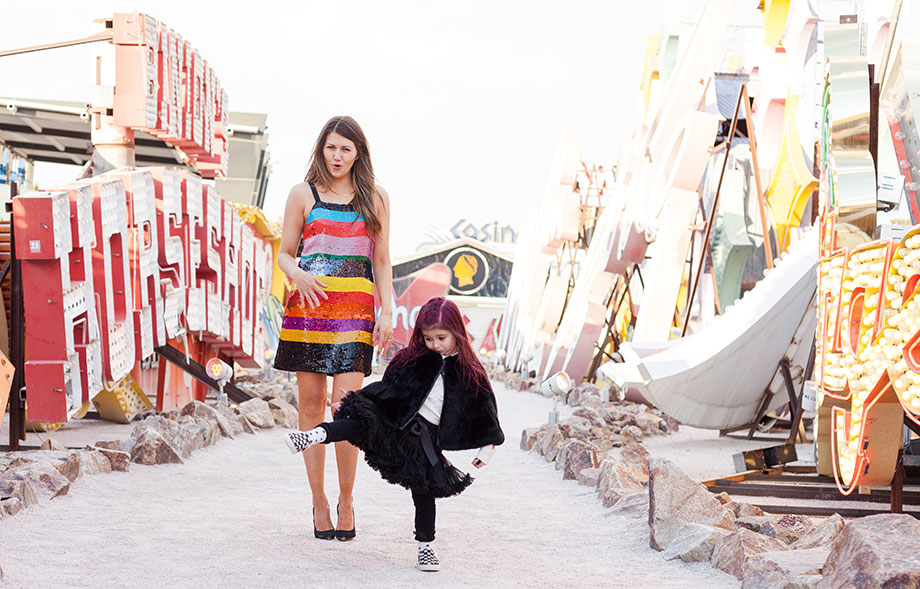 Zelda of Glitter and Bubbles poses at the Neon Museum in this Las Vegas Travel Guide.