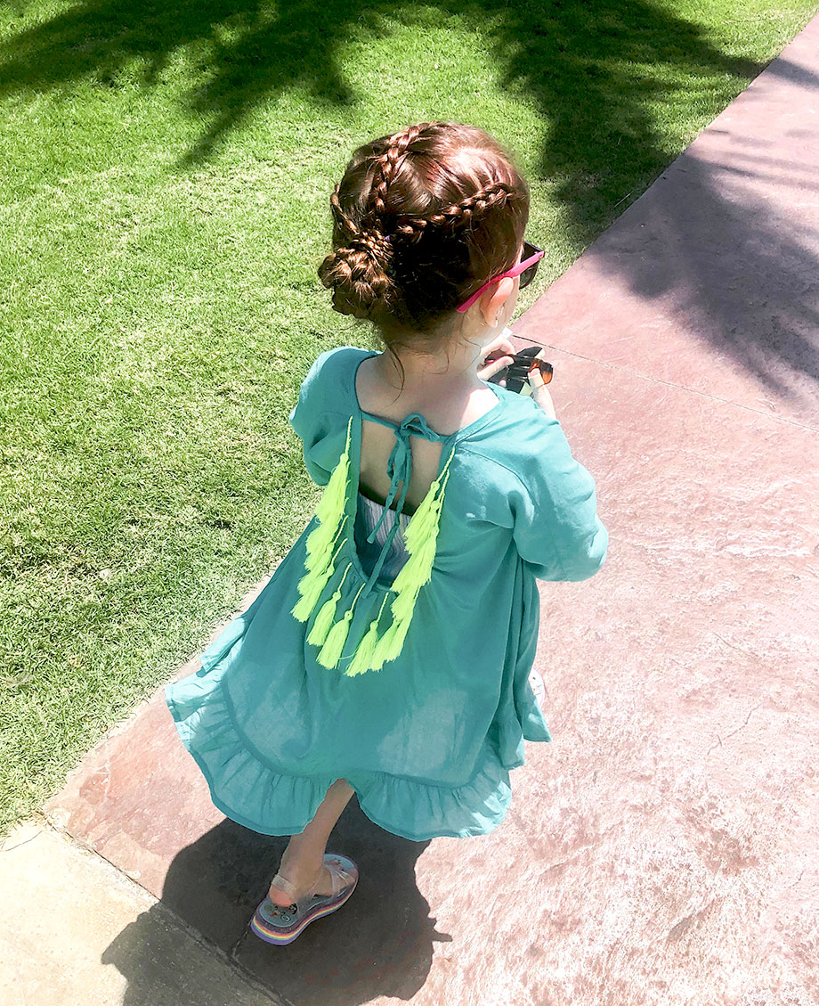 Zelda of Glitter and Bubbles wears vacation braids and a swimsuit cover up.