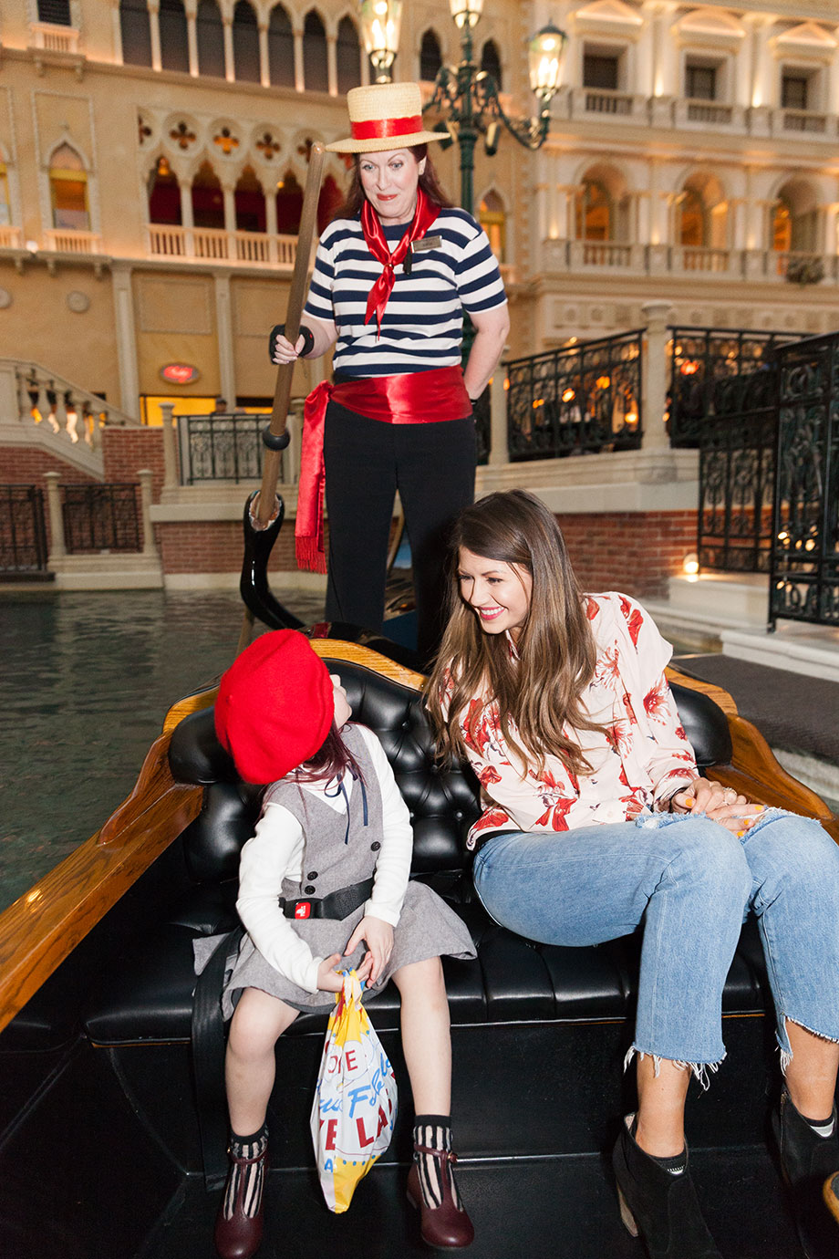 A mother and daughter take a gondola ride in Las Vegas.