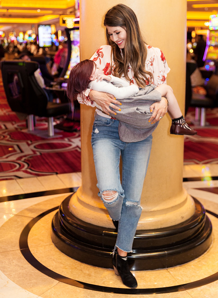 A mother holds her sleeping toddler at the Ventian in Las Vegas.