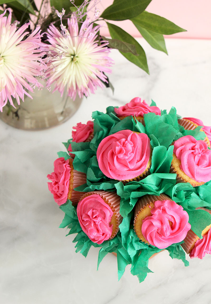 Pink cupcakes frosted to look like flowers.