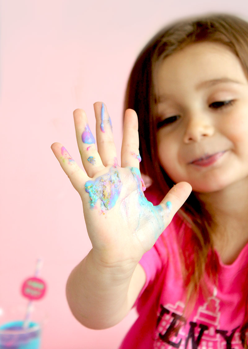 Zelda of Glitter and Bubbles shows her unicorn ice cream hands.