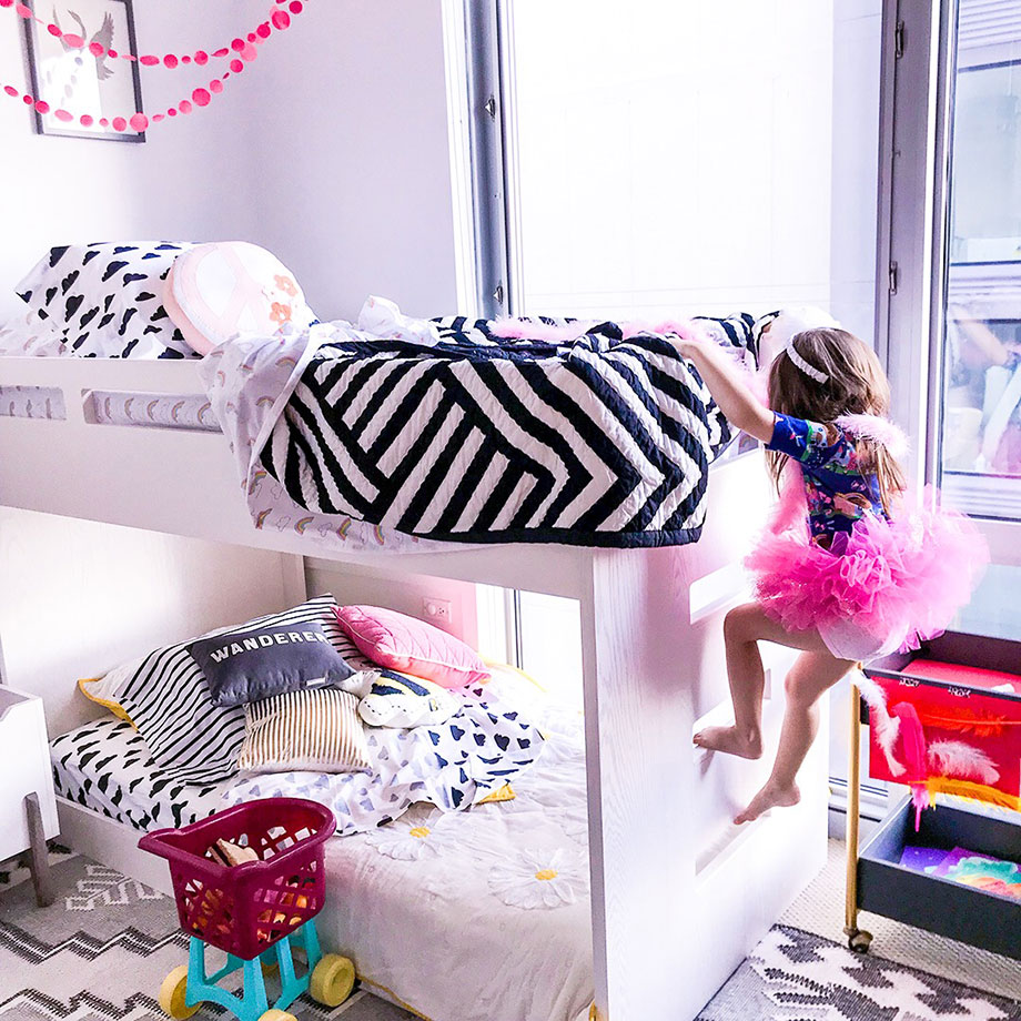 Zelda of Glitter and Bubbles plays dress up in a pink tutu on her Crate & Barrel bunk beds.