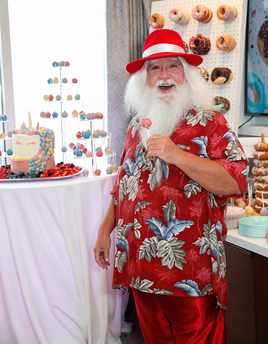 Santa eats a cake pop at the Swissotel in Chicago.