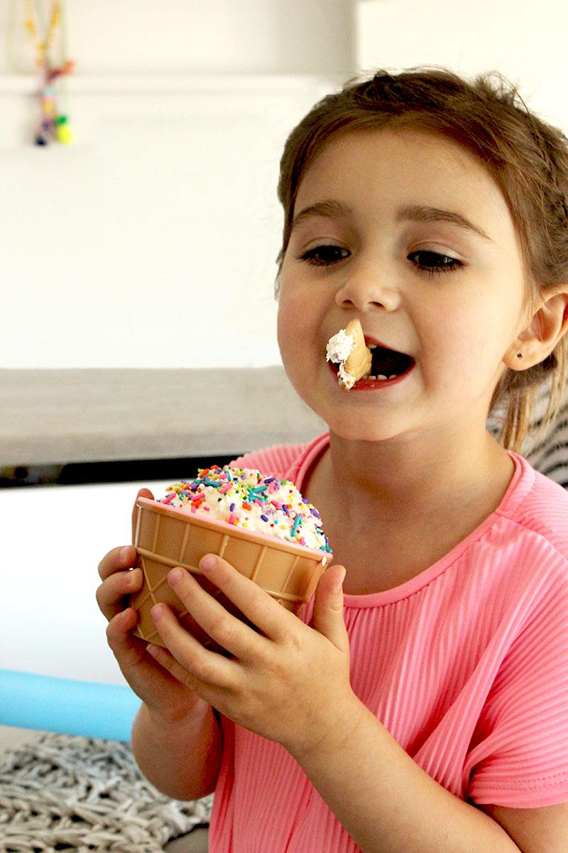 Zelda of Glitter and Bubbles eats cake batter dip.