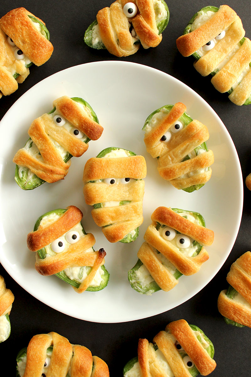 How to make mummy jalapeño poppers for Halloween.
