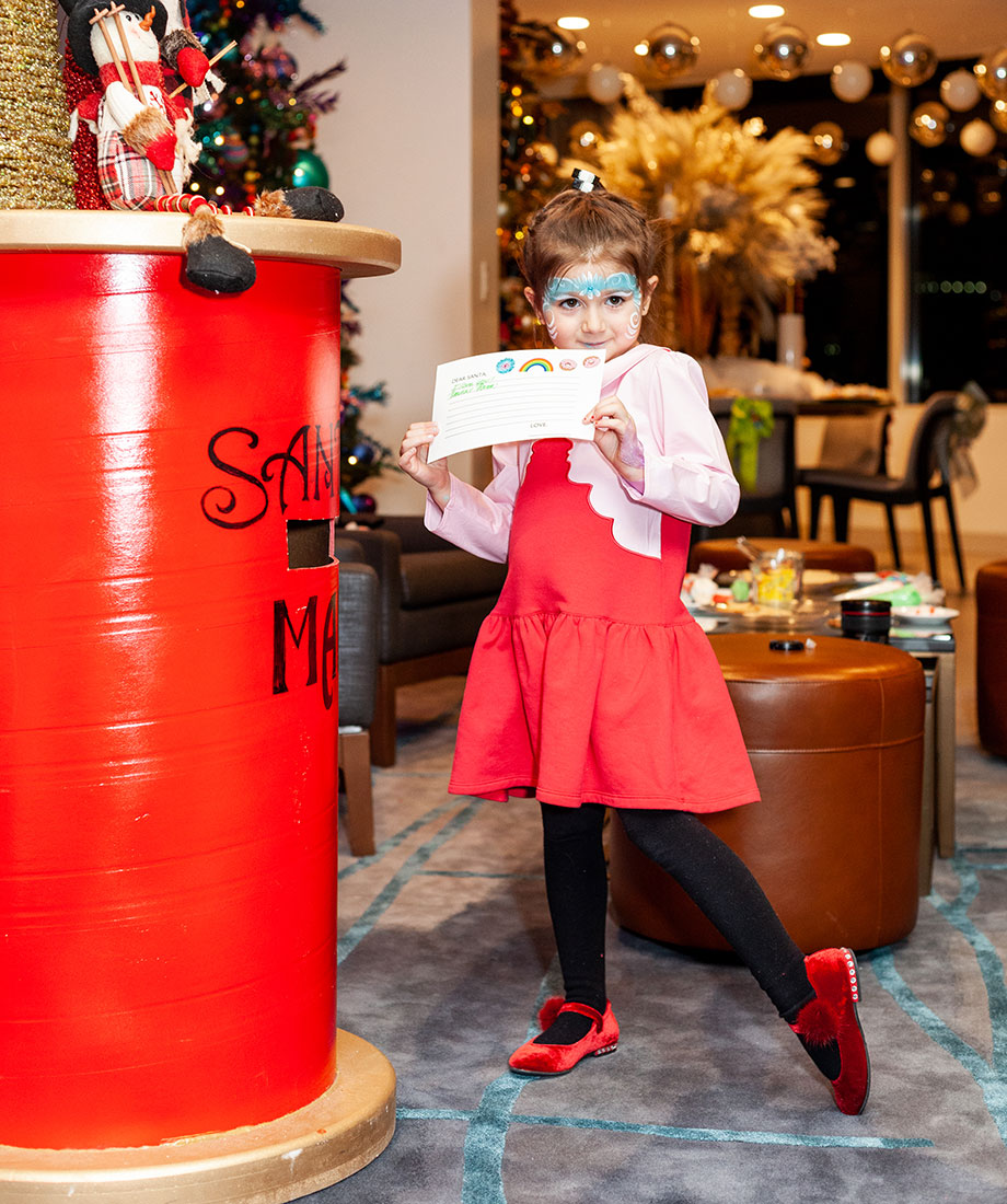 Zelda writes a special letter to Santa in the Swissotel Santa Suite.