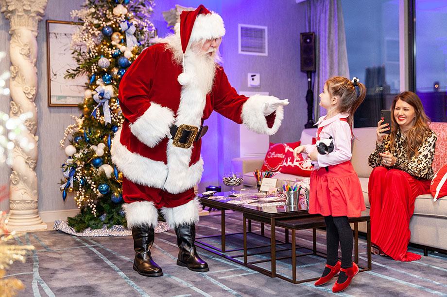 Zelda chats with Santa in the Swissotel Santa Suite.