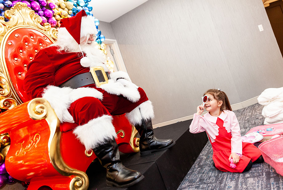 A child chats with Santa on Christmas.