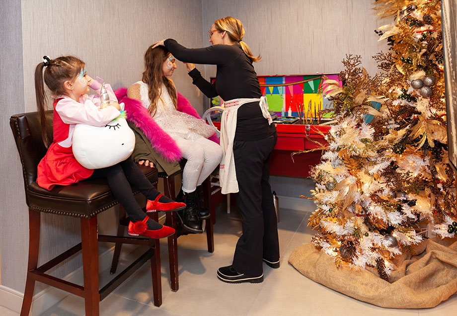 Zelda and Corri get their faces painted at the Swissotel Santa Suite.