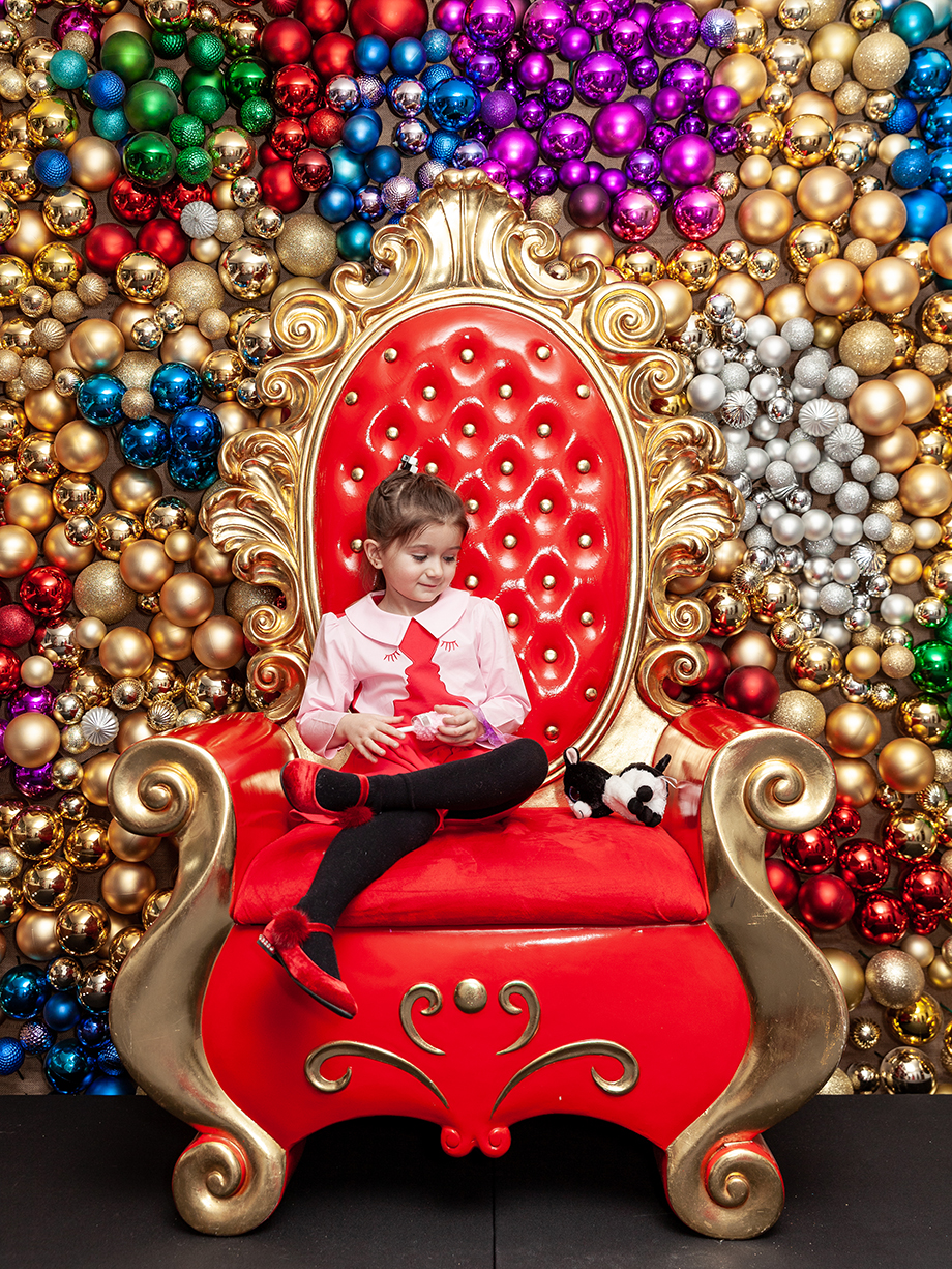 Zelda sits in Santa's Chair at the Swissotel.