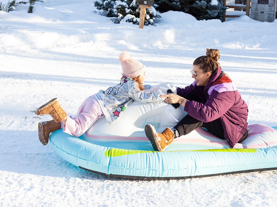 Corri McFadden and Zelda of Glitter and Bubbles play outside in the snow wearing Ugg boots.