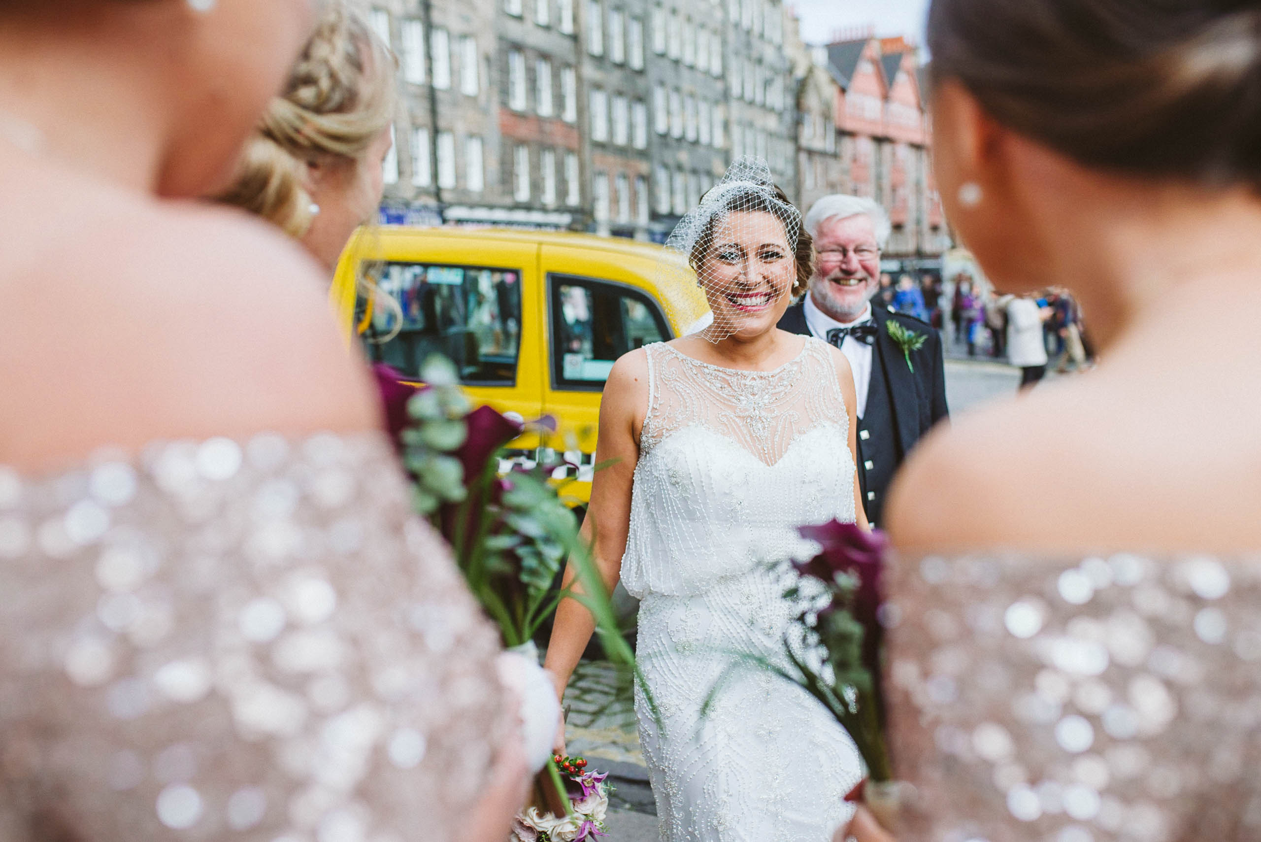 Bride and dad meeting her bridesmaids before the ceremony at The Hub, Edinburgh
