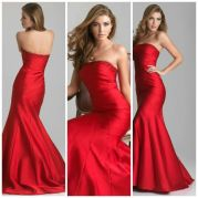 6641: Every girl dreams of the perfect mermaid dress, and this scarlet, strapless one might just be it. The classic mermaid silhouette of this Night Moves style is revamped with sophisticated draping and beading that runs diagonally in curved lines from the right side to the bottom of this stunning style. This gown is elegant, classic, and gives off a 1930's glamorous air.