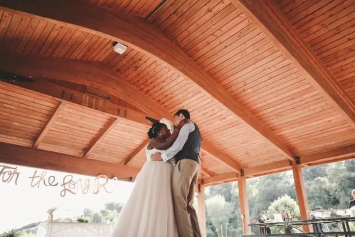 bride and groom under pavillion