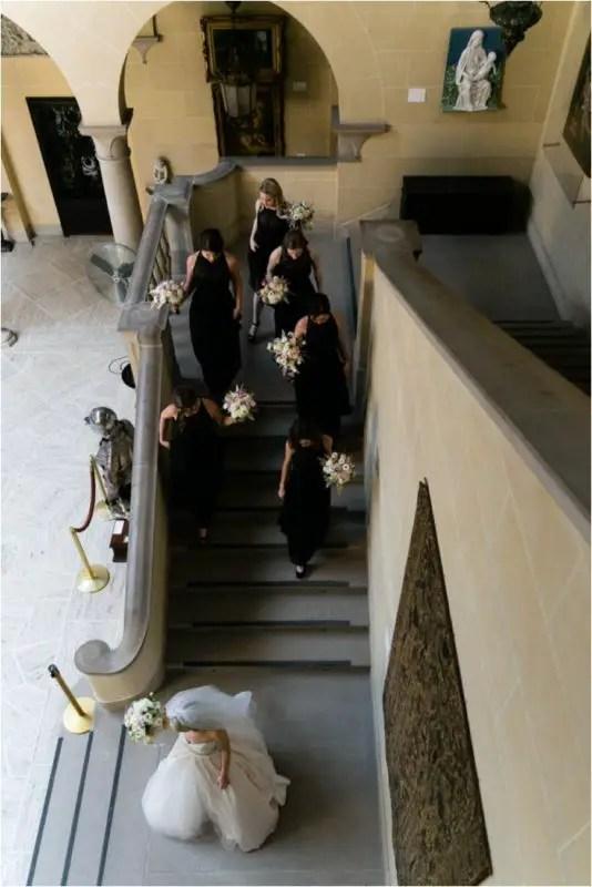bride walking through mansion stairs