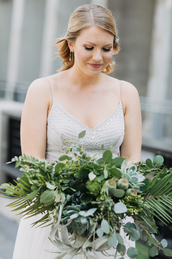 bride holding green bouquet