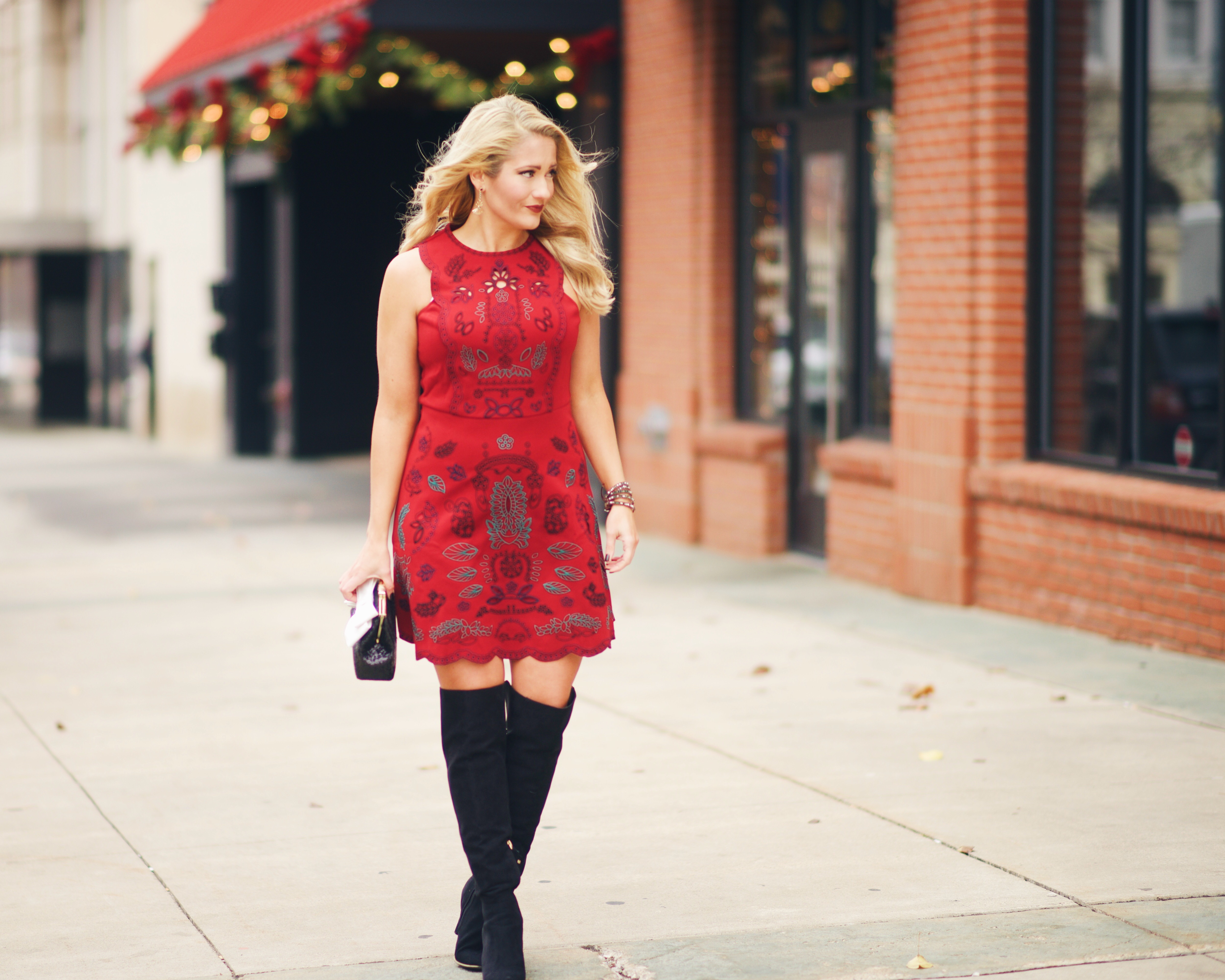 red embroidered dress with black over the knee boots