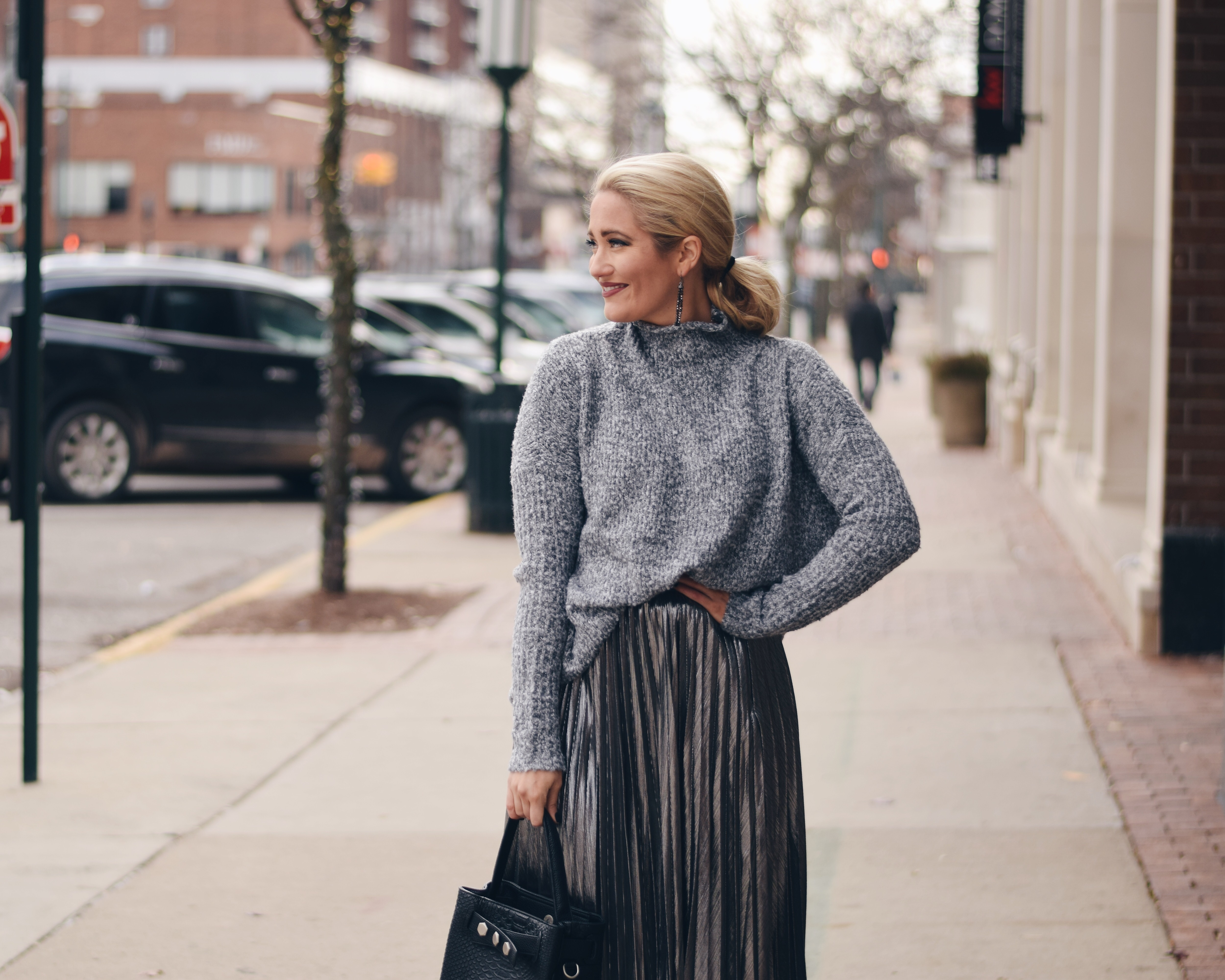 Grey sweater with silver pleated midi skirt