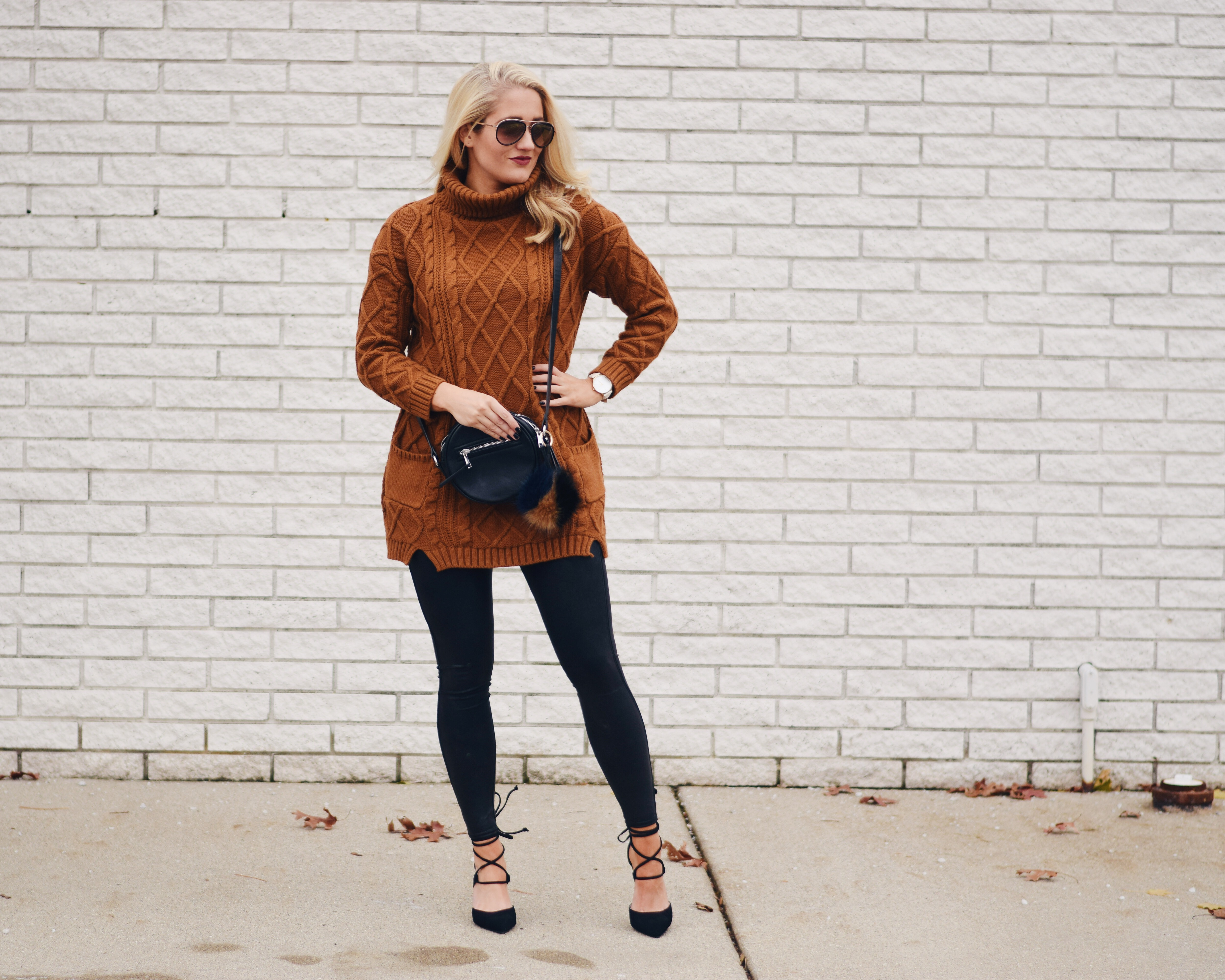 Long brown sweater and black leather leggings