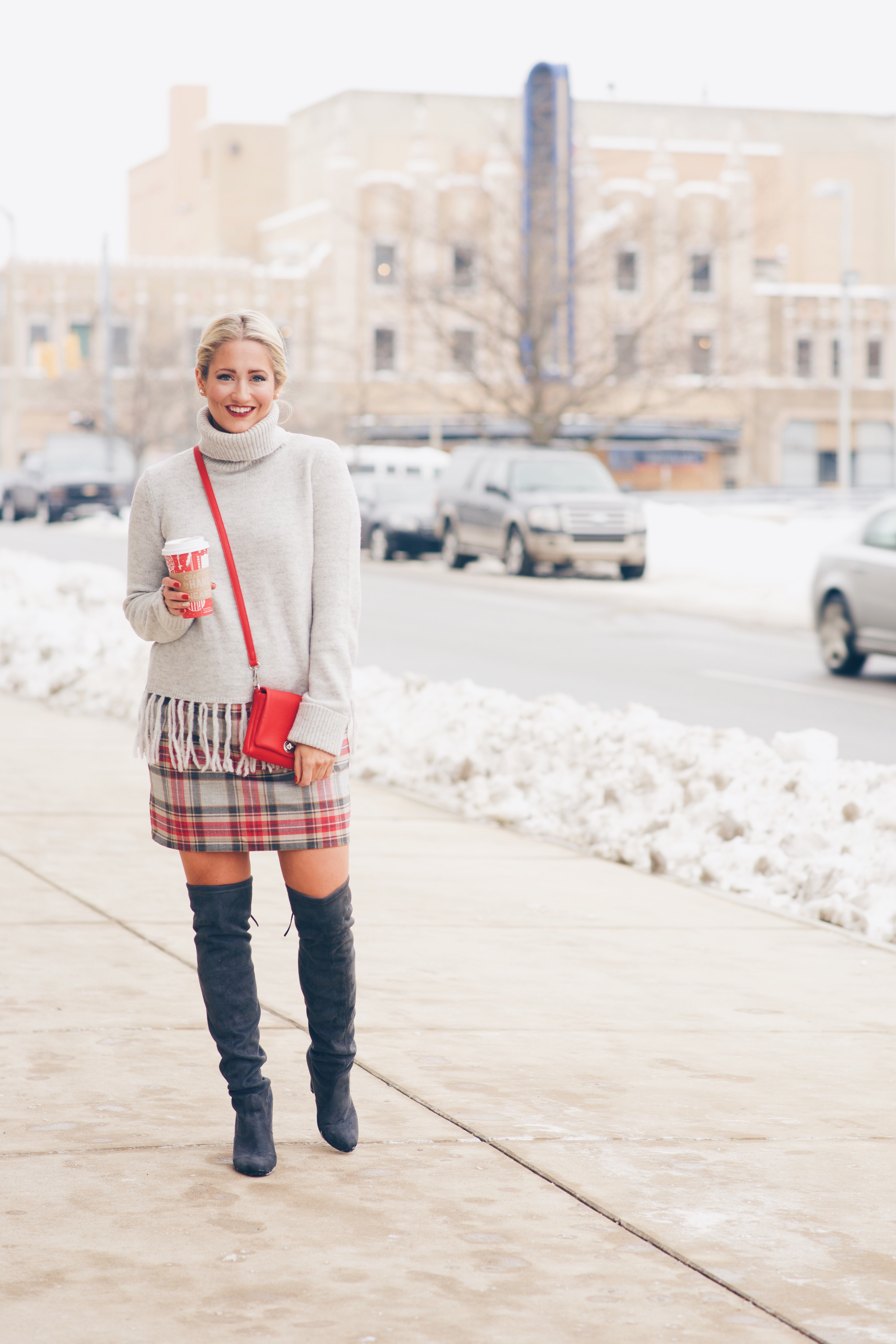 plaid skirt with grey sweater and grey over the knee boots