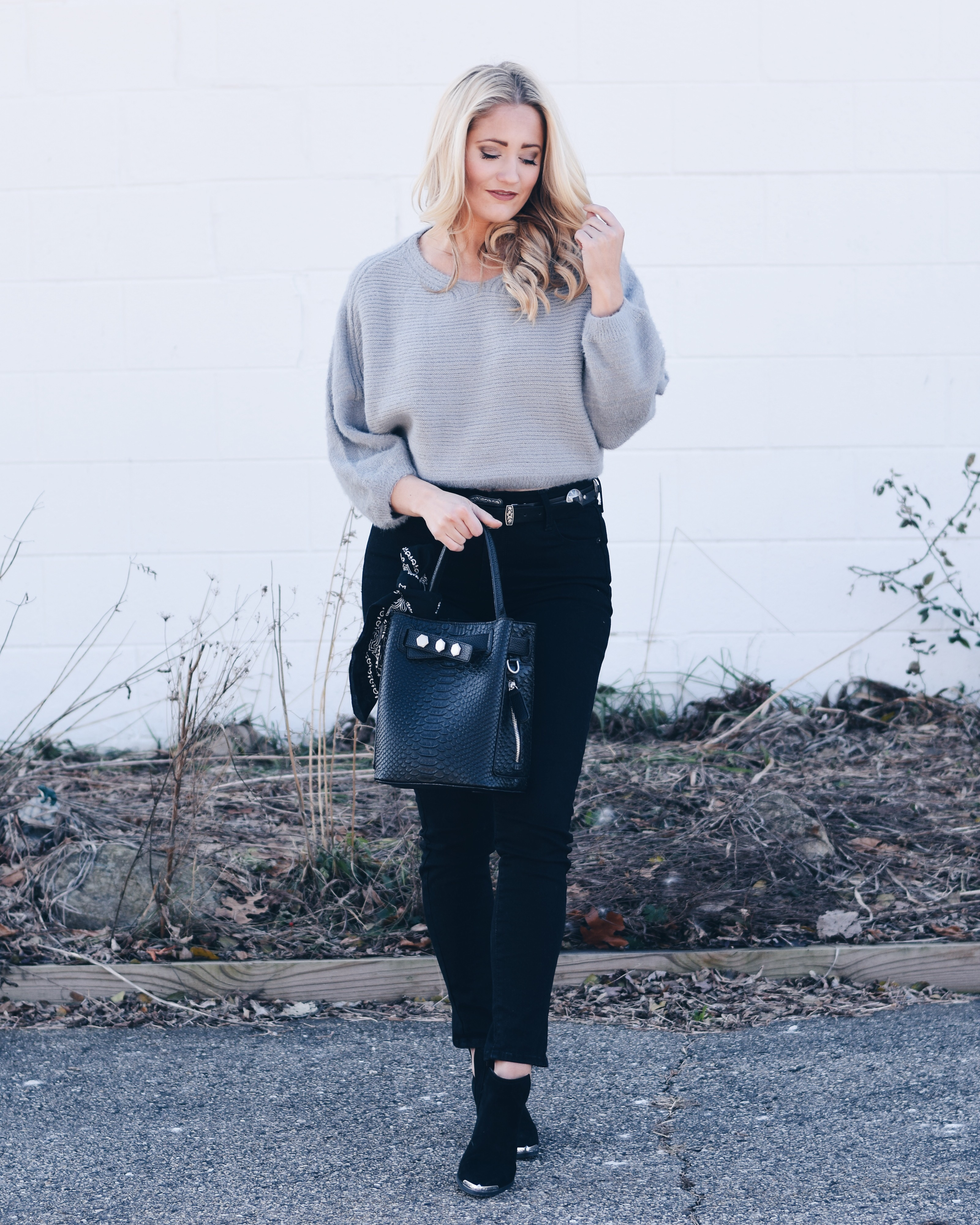 fuzzy batwing sweater with black jeans and western booties