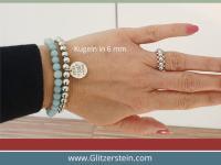Armband Fertigung inklusive Glitzerstein-Logo