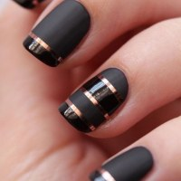 Black Matte Nails with Rose Gold Strips for Detail