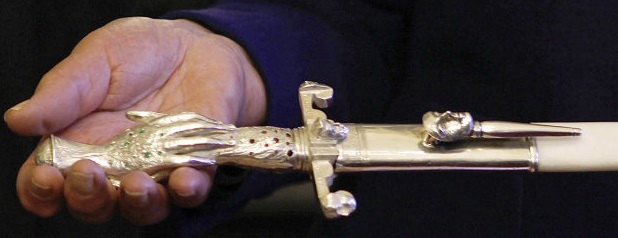 Detail of the hand of French politician Simone Veil as she displays her ceremonial epee she received as a new member of the French Academy during a ceremony at the French Senate in Paris, on March 16, 2010. Veil will officially become a member of the French Academy (Academie Francaise) in a ceremony in Paris on March 18, 2010. AFP PHOTO CHARLES PLATIAU / AFP PHOTO / CHARLES PLATIAU