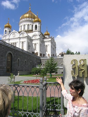 A Tour Guide in Moscow Shows Visitors the Cathedral of Christ the Saviour