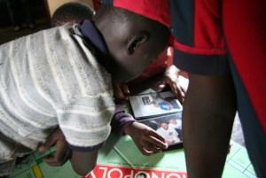 Host siblings in Kenya look at pictures from Seattle, 2006