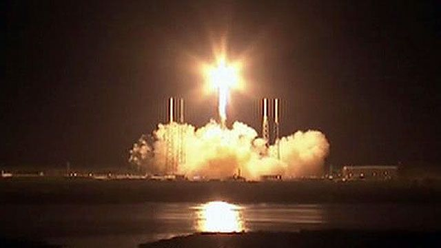 SpaceX Rocket blasts off with Dragon capsule on top