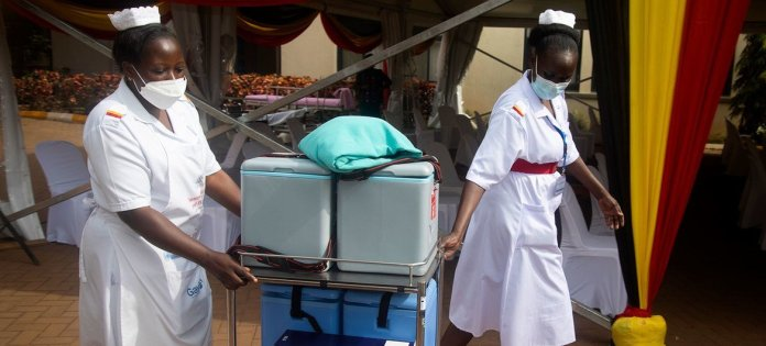 In Uganda, vaccines are being delivered to remote areas on foot, boats and motorcycles.