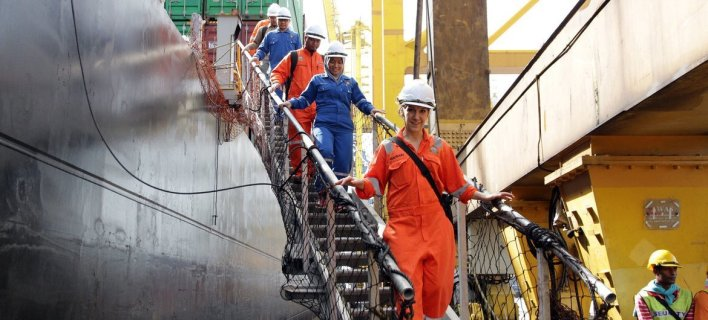 Seafarers working on a container ship in Johor Port, Malaysia.