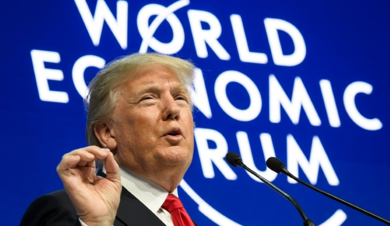 Trump woos Davos with pacific trade deal shift